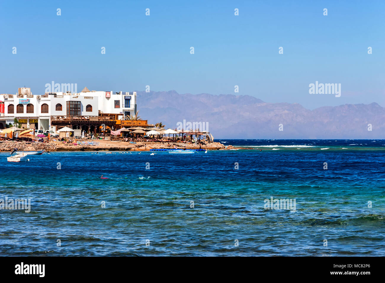DAHAB, EGYPT - SEPTEMBER 2, 2010: Beautiful view of Red Sea coast and hotels in Dahab, Egypt. Dahab is now considered to be one of Sinai's most treasu - Stock Image