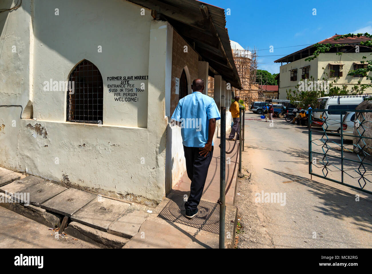 STONE TOWN, ZANZIBAR - JANUARY 9, 2015: Street of Stone Town on sunny day. Stone Town is the oldest part of Zanzibar City which was a UNESCO World Her - Stock Image