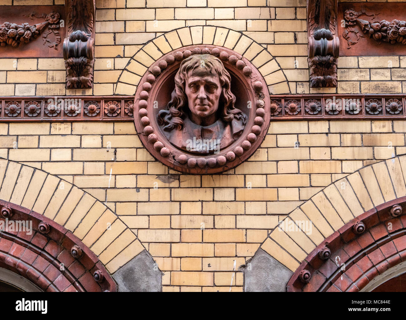 Roundel of a man resembling Edward Colston the formerly revered but lately reviled philanthropist and slave trader on city centre building Bristol UK - Stock Image