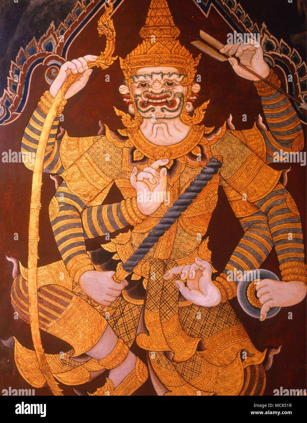 A suix-armed demon king on the intrior frescoes of the Grand Palace at Bangkok, Thailand.  Eighteenth century. - Stock Image