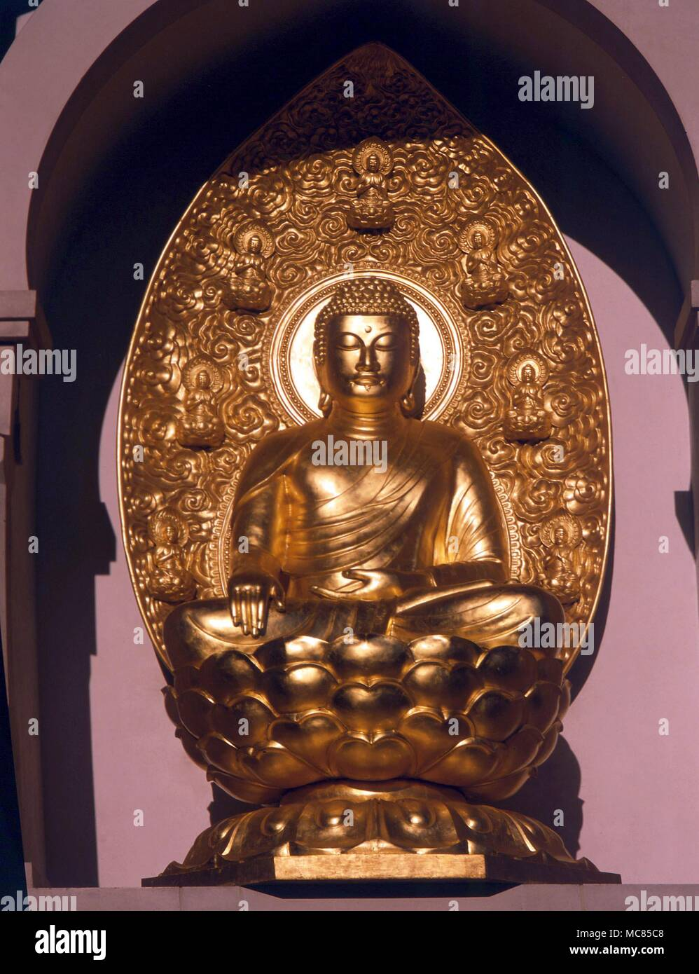 Buddha seated on the lotus flower detail of the buddhist temple in buddha seated on the lotus flower detail of the buddhist temple in battersea park london izmirmasajfo