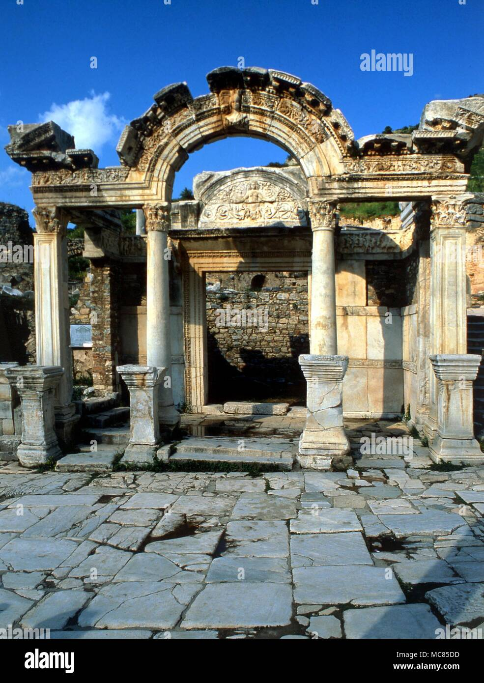 The ancient Roman temple of the Emperor Hadrian , on the Sacred Way at Ephesus, Turkey. Ephesus was the site where a Mother Goddess was first worshipped, where earth and heaven met, in Diana of Ephesus, and (later) where the cult of the Virgin Mary was ratified. - Stock Image