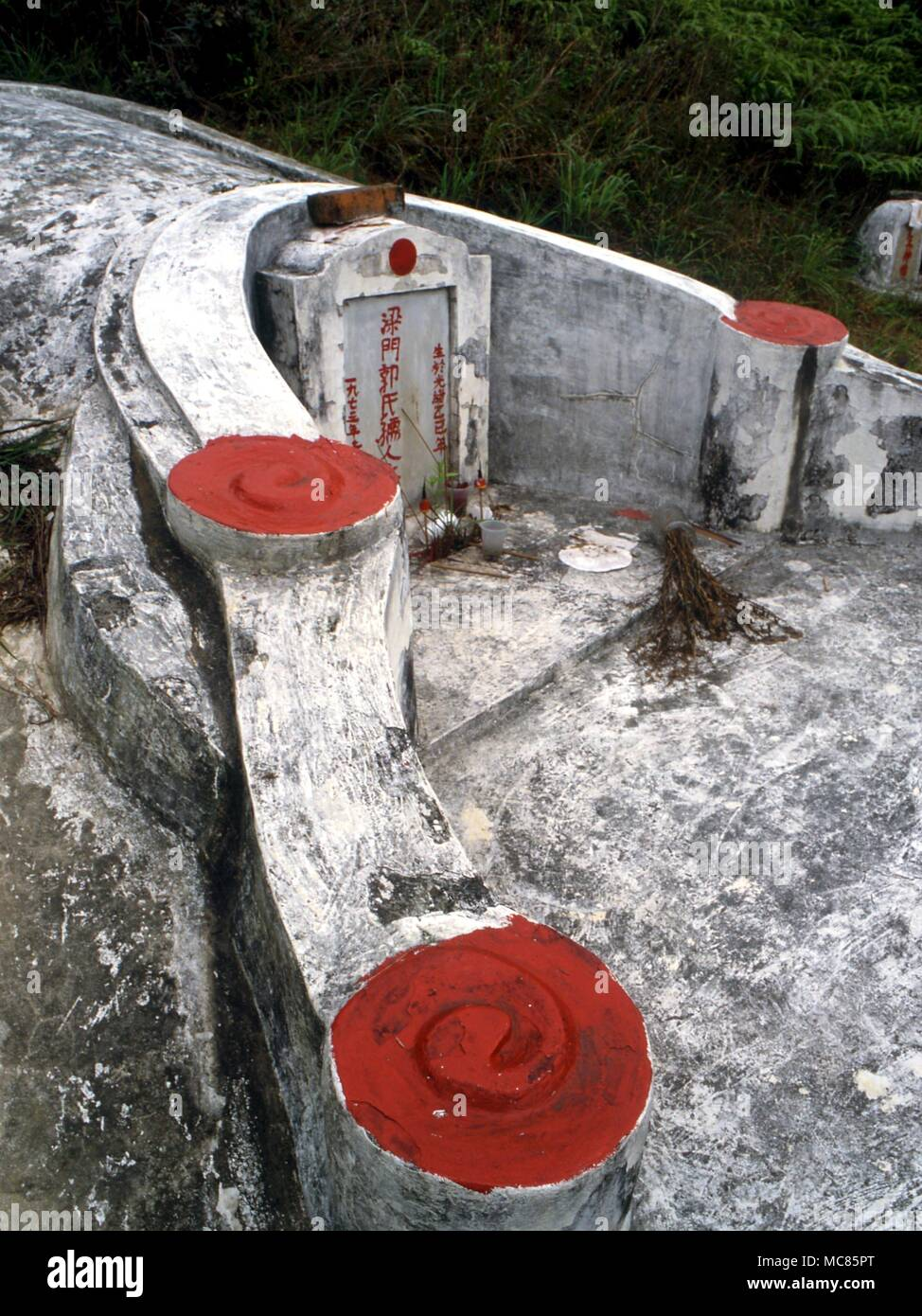 GRAVEYARD Chinese tombs.  The placing of Chinese tombs is determined stricly by Feng Shui considerations, as is their decoration.  Chinese burial ground near Hong Kong Stock Photo
