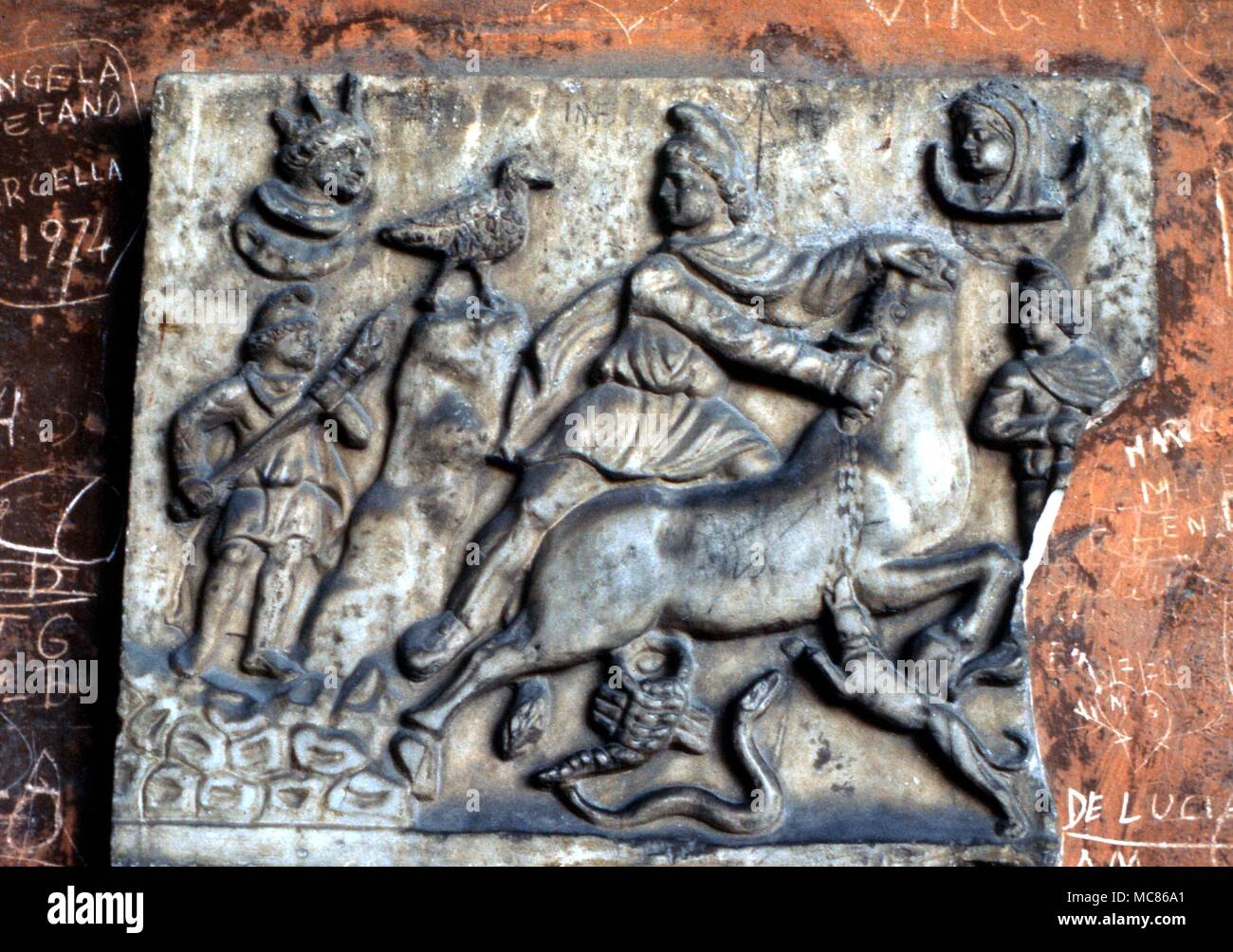 Mithraism Bas relief showing Mithras and the bull, with Sun and Moon.  From the Campo Santo museum, Pisa - Stock Image