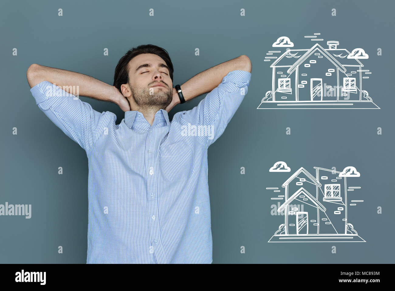 Ambitious student thinking about buying a house - Stock Image