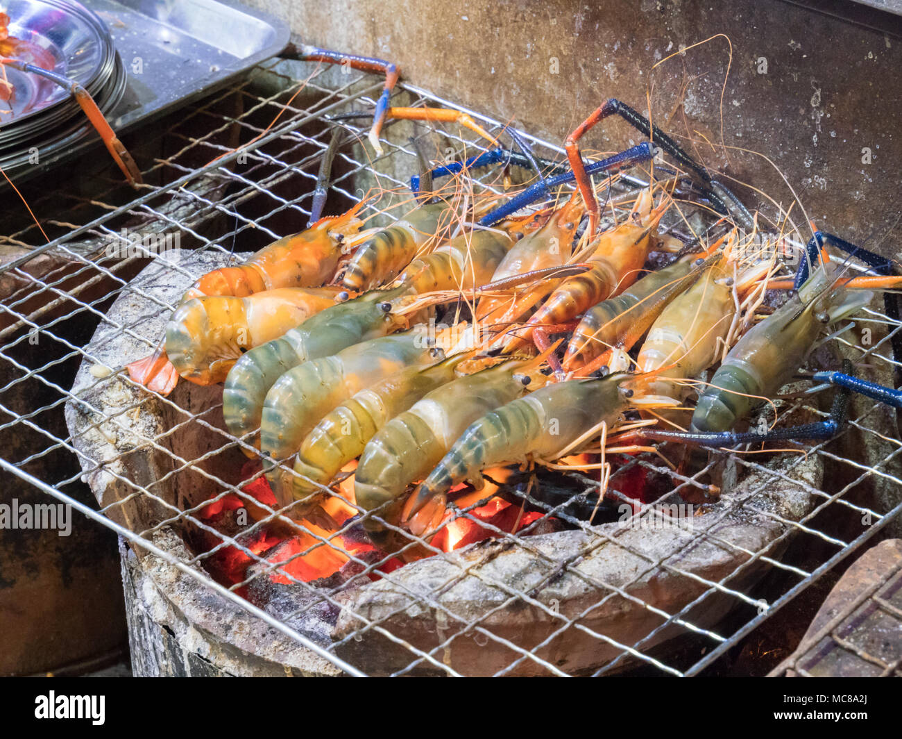 Prawns Cooking On A Charcoal Grill On A Street Food Stall In Bangkok Thailanad Stock Photo Alamy