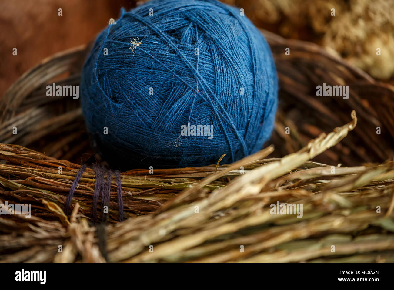 Blue ball of wool and ingredients used to create color, El Balcon del Inka, Chinchero, Cusco, Peru Stock Photo