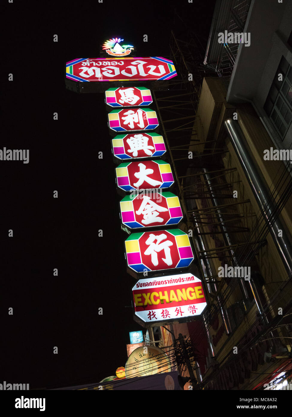 A neon sign on a building  in Chinatown Bangkok - Stock Image