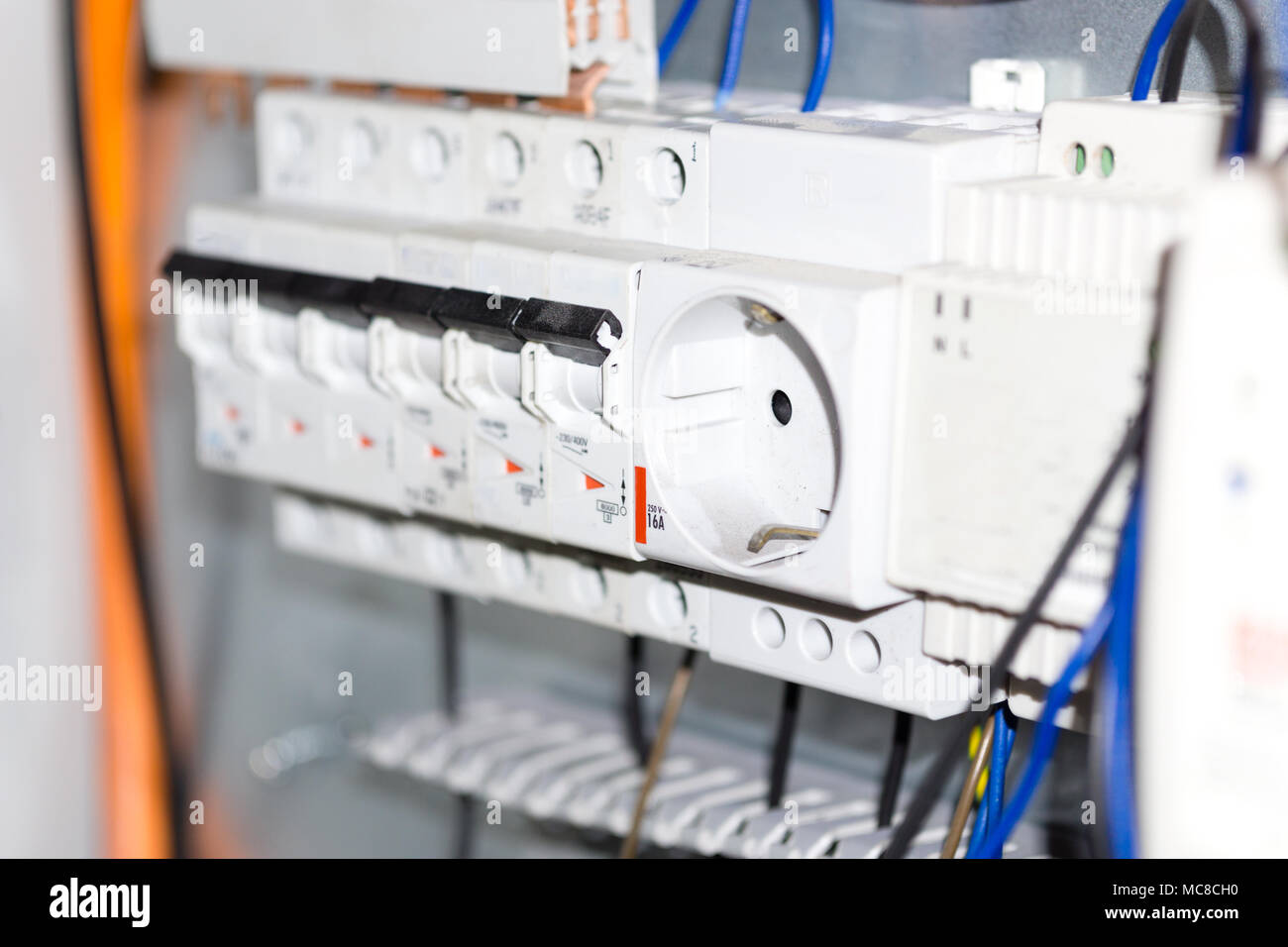 Electrical equipment components installation in fuse box. Wiring and ...