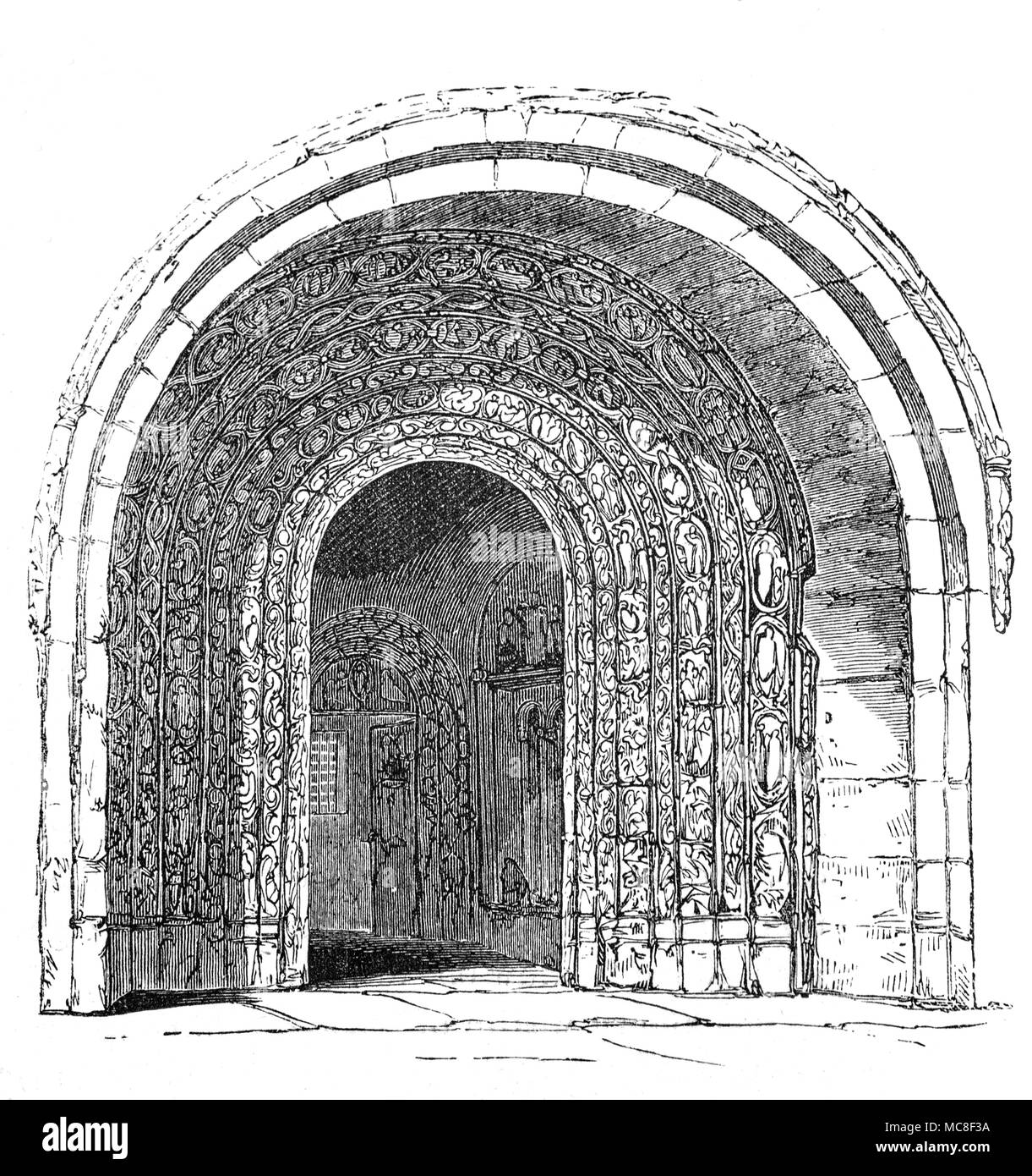 The Romanesque porch and door of Malmesbury Abbey, in Wiltshire, England, one of the few English houses with a continuous history from the 7th century through to the Dissolution of the Monasteries. The Abbey was founded as a Benedictine monastery around 676 by the scholar-poet Aldhelm, a nephew of King Ine of Wessex. The current Abbey was substantially completed by 1180 but its tower collapsed in a storm around 1500 destroying much of the church, including two thirds of the nave and the transept. - Stock Image