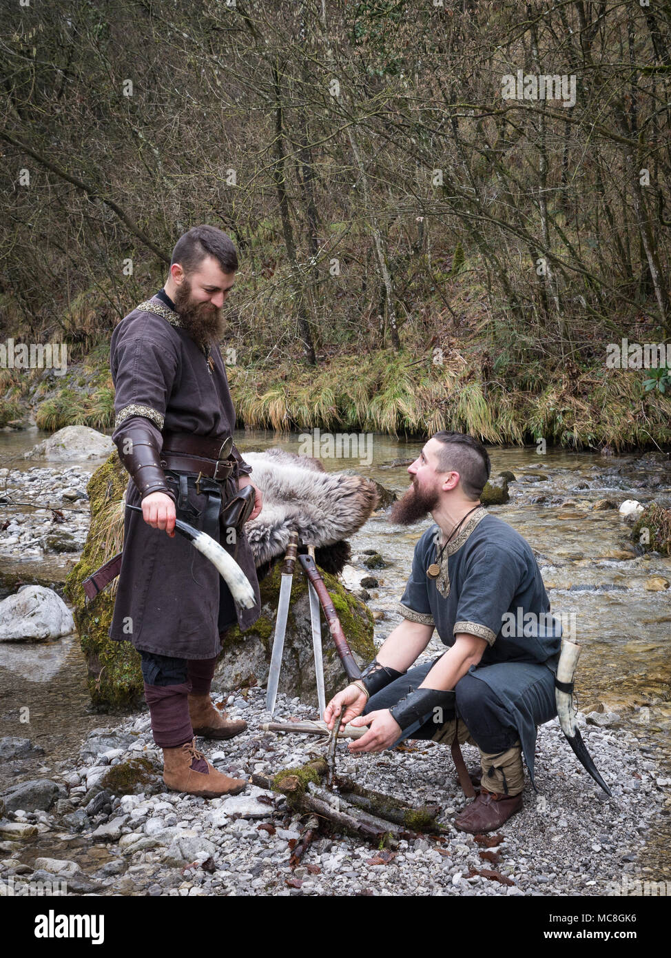 two Vikings in the forest on the banks of the river - Stock Image
