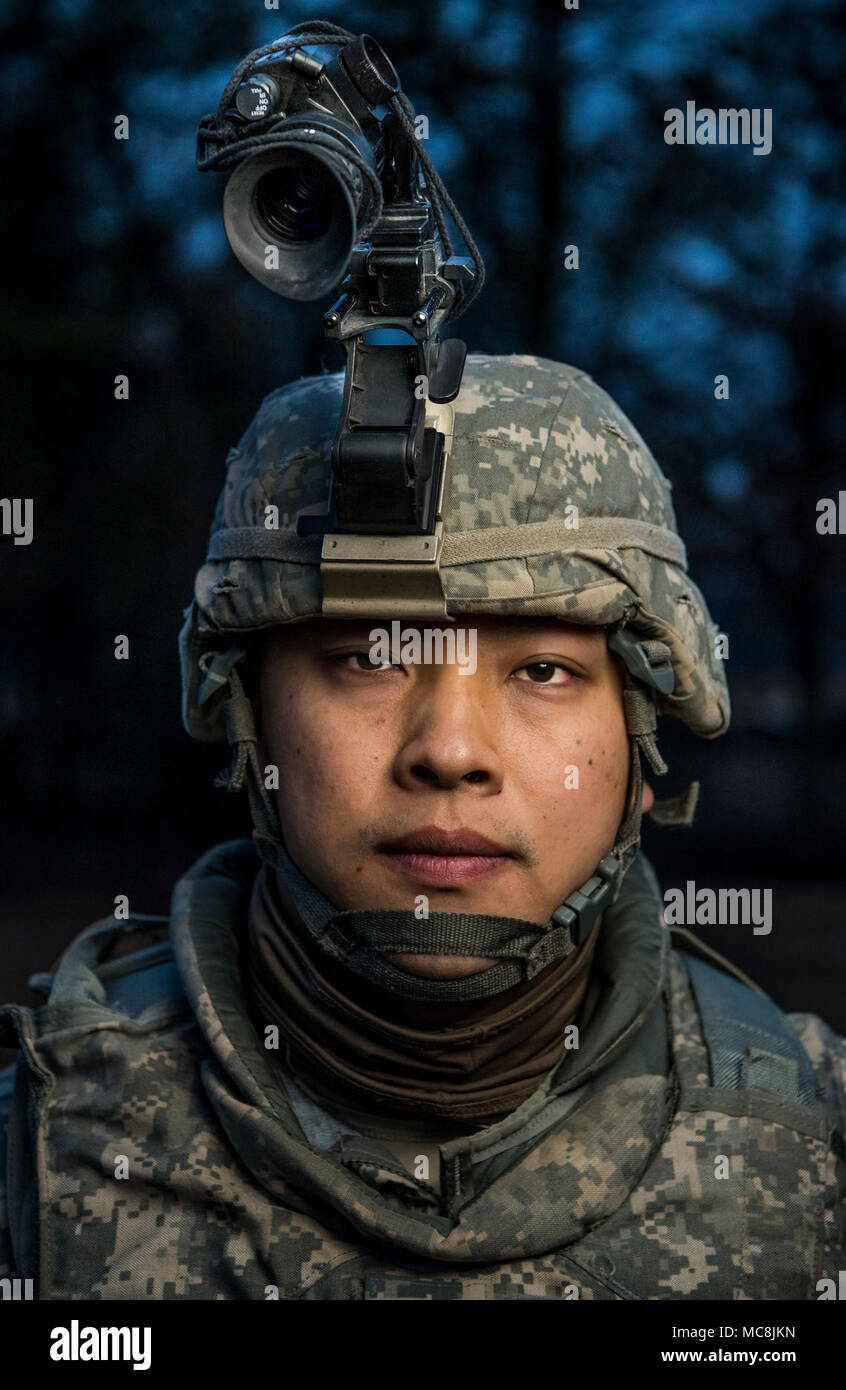 Spc. Fei Lin, a U.S. Army Reserve military police with the 94th Military Police Company, out of Londonderry, New Hampshire poses for a portrait during Operation Cold Steel at Fort McCoy, Wisconsin, March 26, 2018.  This iteration of Cold Steel is called Task Force Triad, a mounted gunnery training exercise in which Soldiers work as truck teams to quailfy on live-fire driving lanes. Task Force Triad runs from February to May. Each team who trains here completes a 14-day cycle that includes primary marksmanship training, a gunner skill test, digital simulated gunnery, ground qualification and fi Stock Photo
