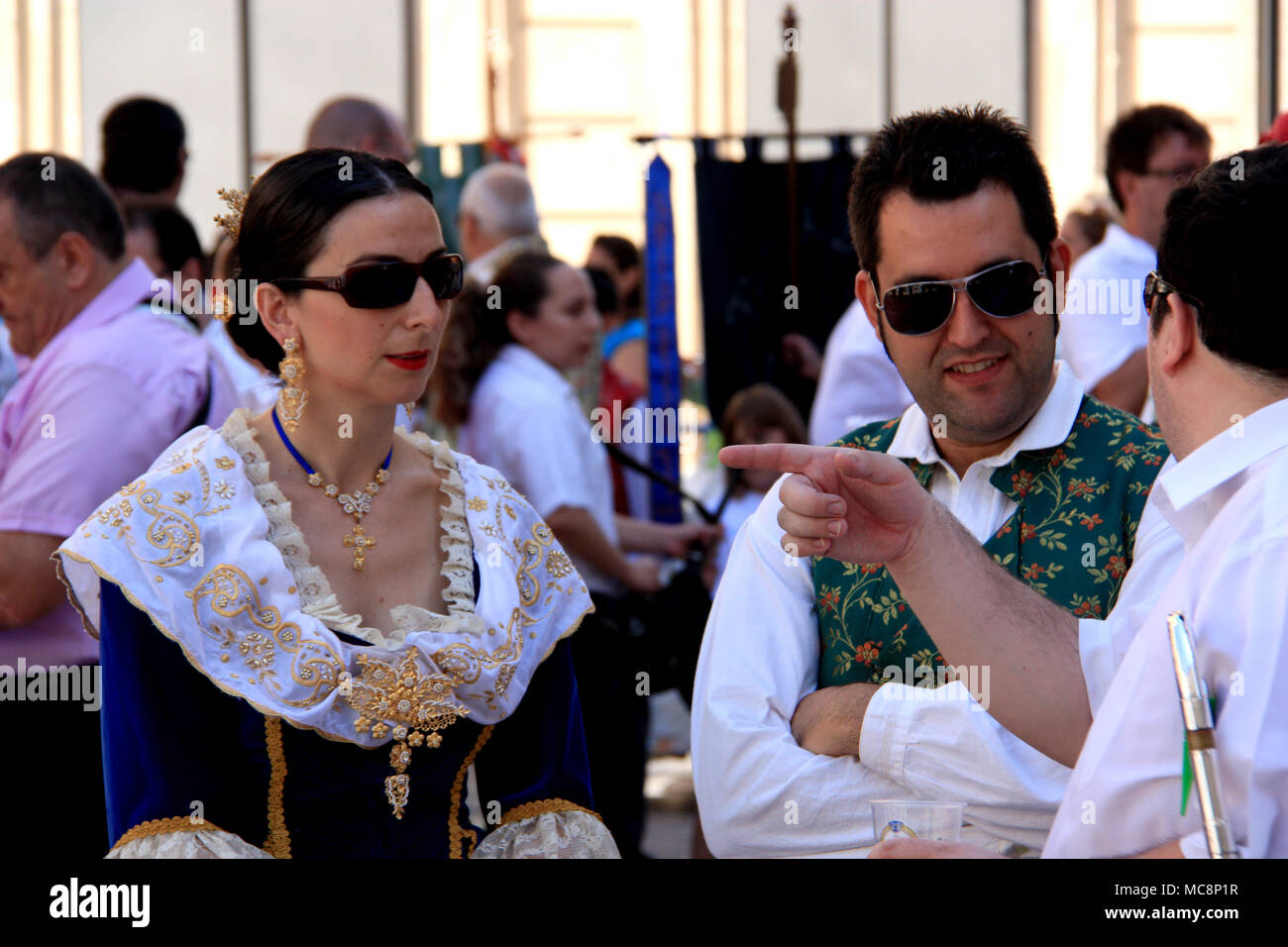 Traditionally dressed up people at the Hogueras de San Juan Festival in Alicante, Spain Stock Photo