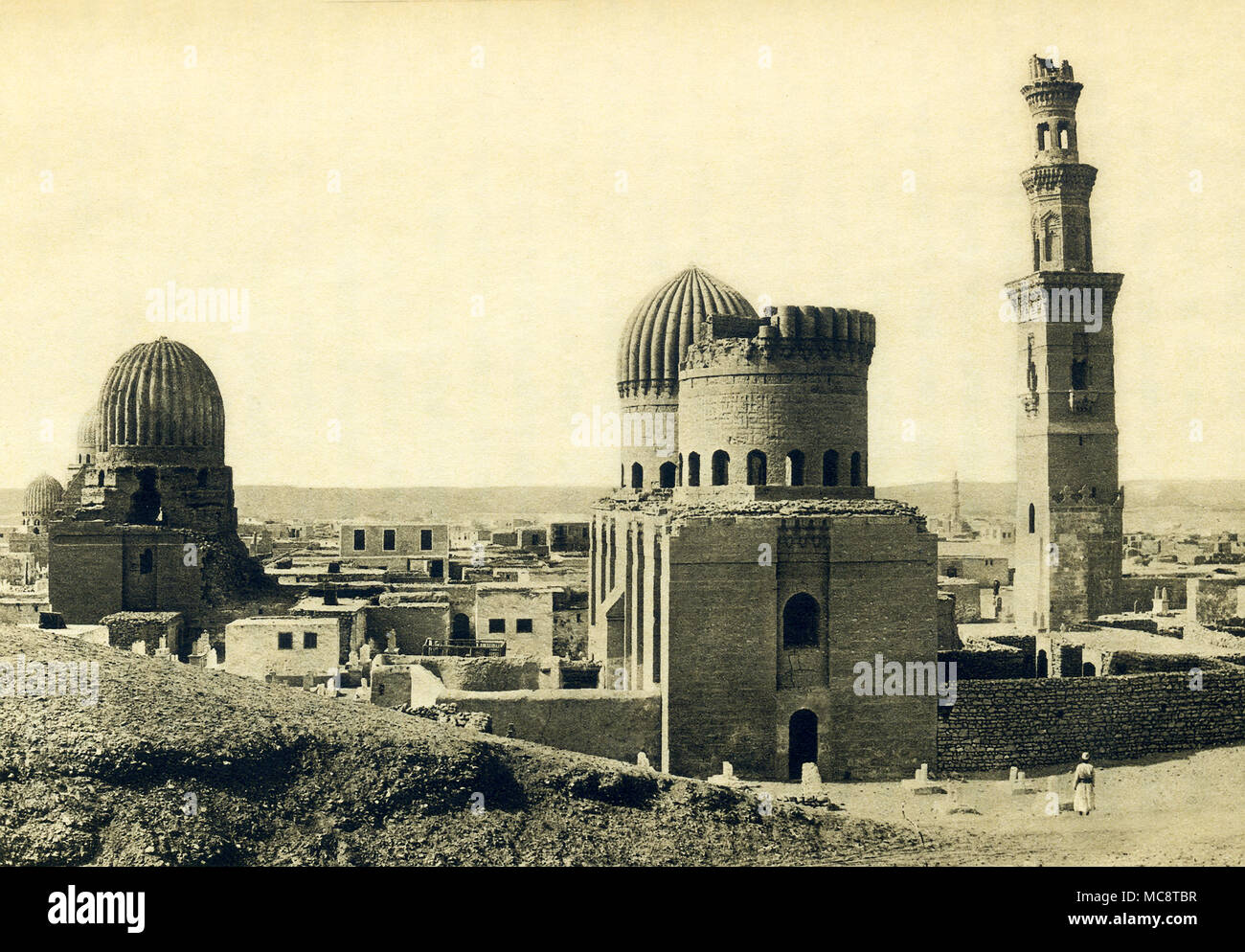 This photo dates to around 1900 and shows the Tombs of the Mamluks in Cairo. The Mamluks were slave soldiers and served the Muslim caliphs and the Ottoman Empire. As the decades passed they became a powerful caste, on accasion, seizing power for themselves. The Mamluk Sultanate of Egypt began in 1250 and ended in 1517 when the Ottomans took control of Egypt. Toward the end of the 14th century, the Mamluk rulers began looking for a new necropolis for themselves and established a cemetery in northern Cairo, the area known as Qarafa. The area is also known as the City of the Dead and the Cairo Ne - Stock Image