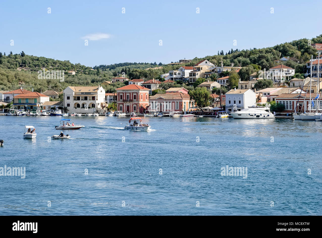 Hot September in Gaios Harbour, Paxi, Greece - Stock Image