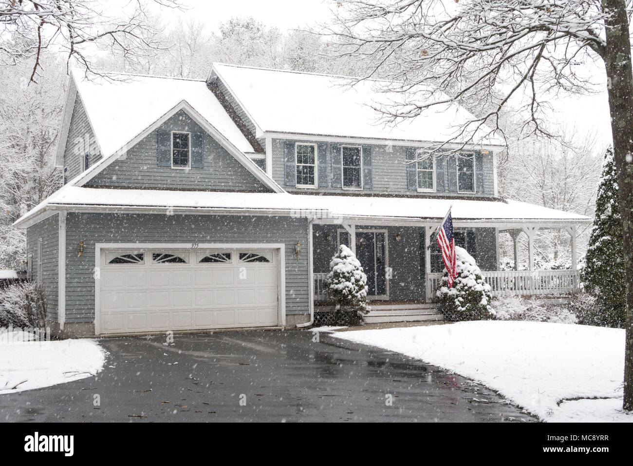 Luxury Suburban House in a Snowstorm, MA, USA - Stock Image