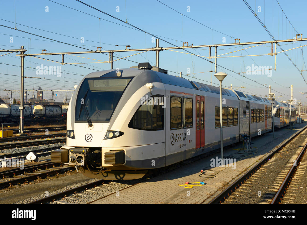 A modern electric multiple unit train parked ready for use at Venlo station in the Netherlands - Stock Image
