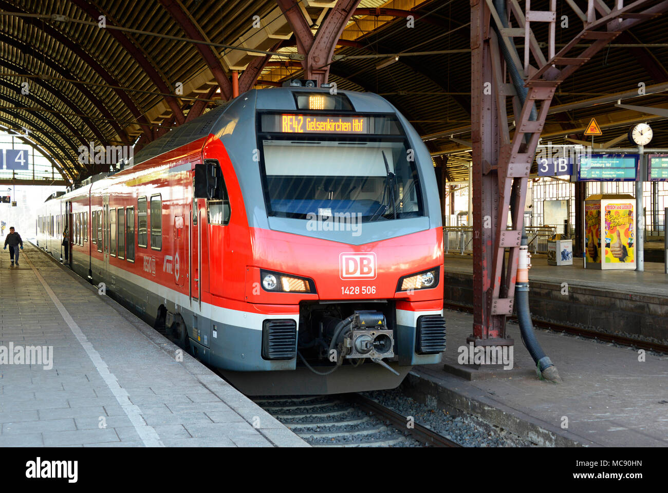 A DB EMU service waits to depart from Monchengladbach station in Germany - Stock Image