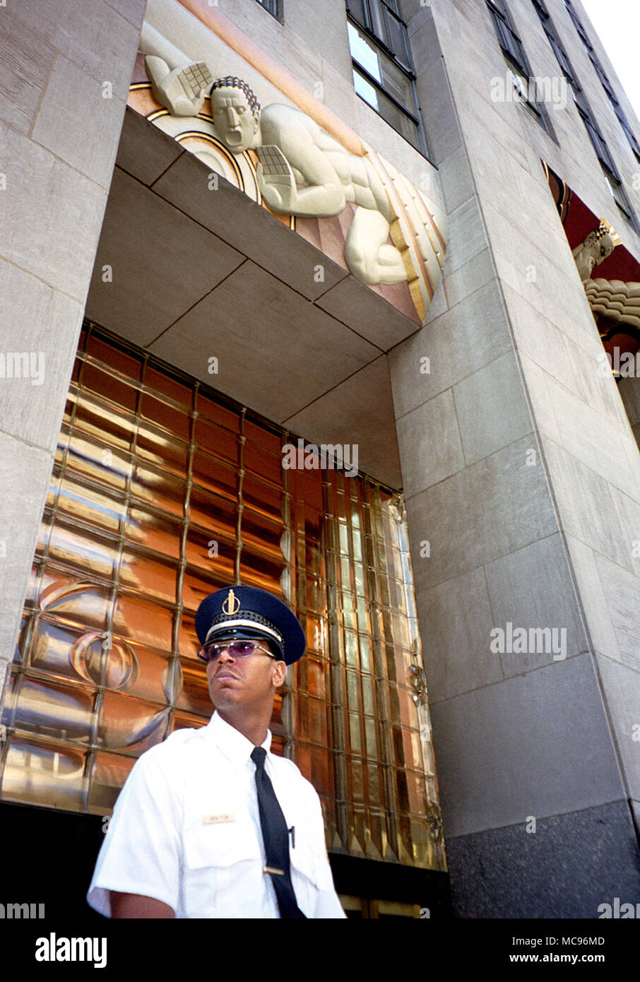 A tough looking security guard stands outside The Rockefeller Centre NYC the day after the terrorist attack on The World Trade Center New York City on 9/11   photo DON TONGE Photographer - Stock Image