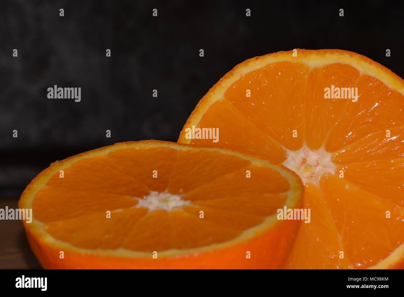 Two Juicy Oranges Black Background - Stock Image