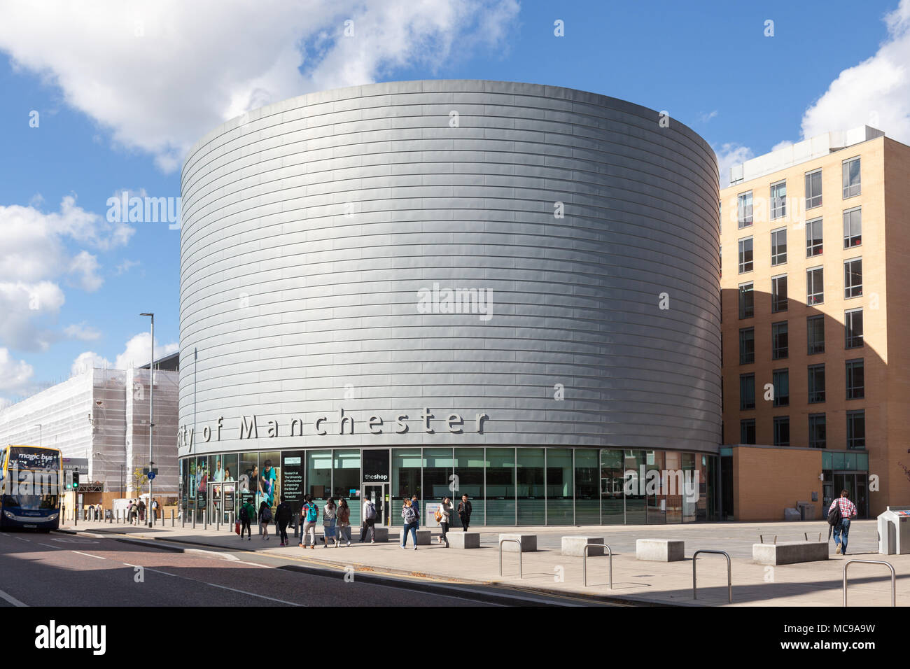 The large, drum-shaped building of The University of Manchester, University Place, Oxford Road, Manchester. - Stock Image