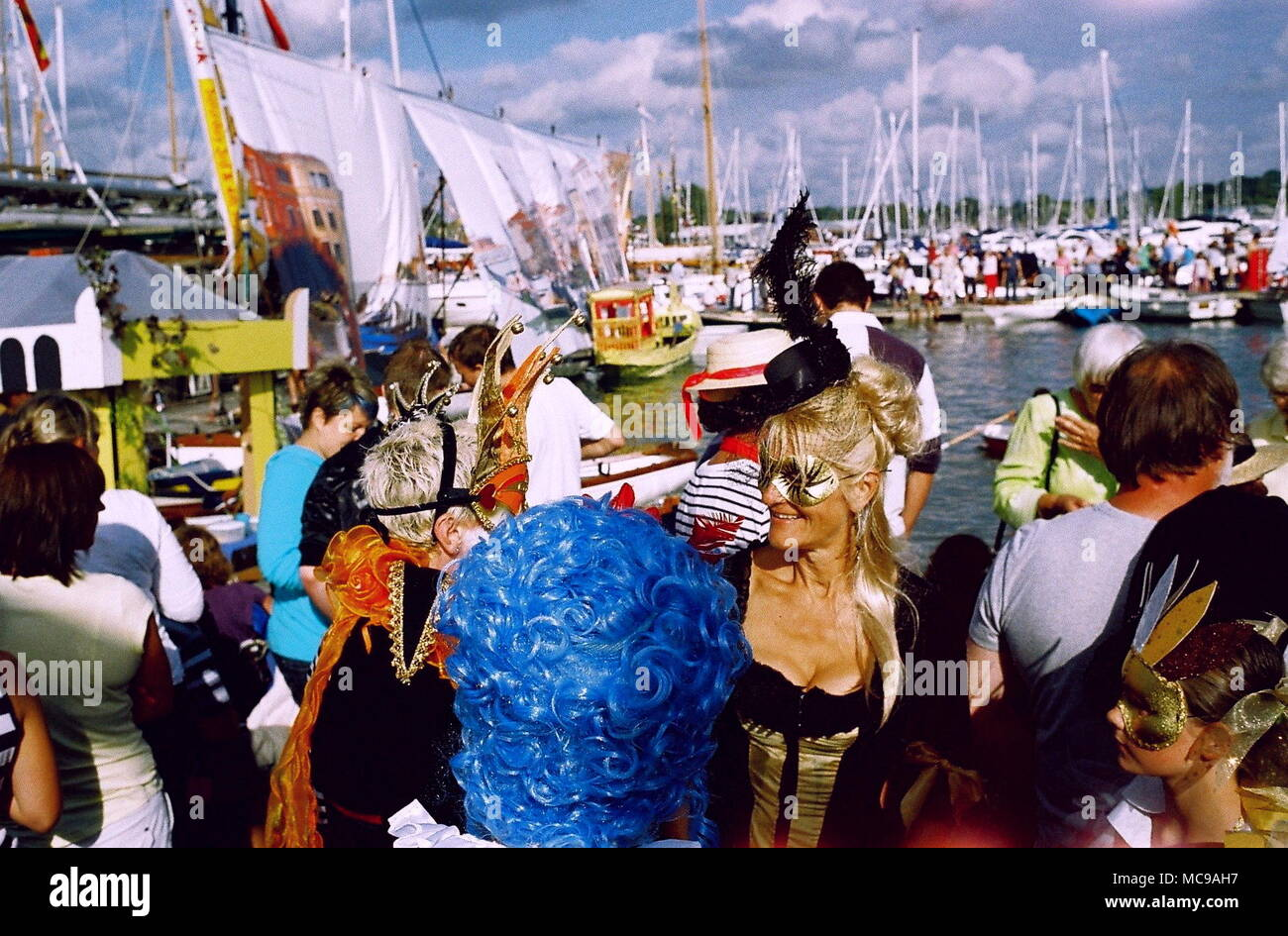 AJAXNETPHOTO. SEPTEMBER, 2011. BURSELDON, ENGLAND. - VENETIAN CARNIVAL THEME - RIVERSIDE SCENE AT THE ELEPHANT BOATYARD AS THE REGATTA GETS UNDER WAY. PHOTO:JONATHAN EASTLAND/AJAX REF:CD1542_24_1 - Stock Image
