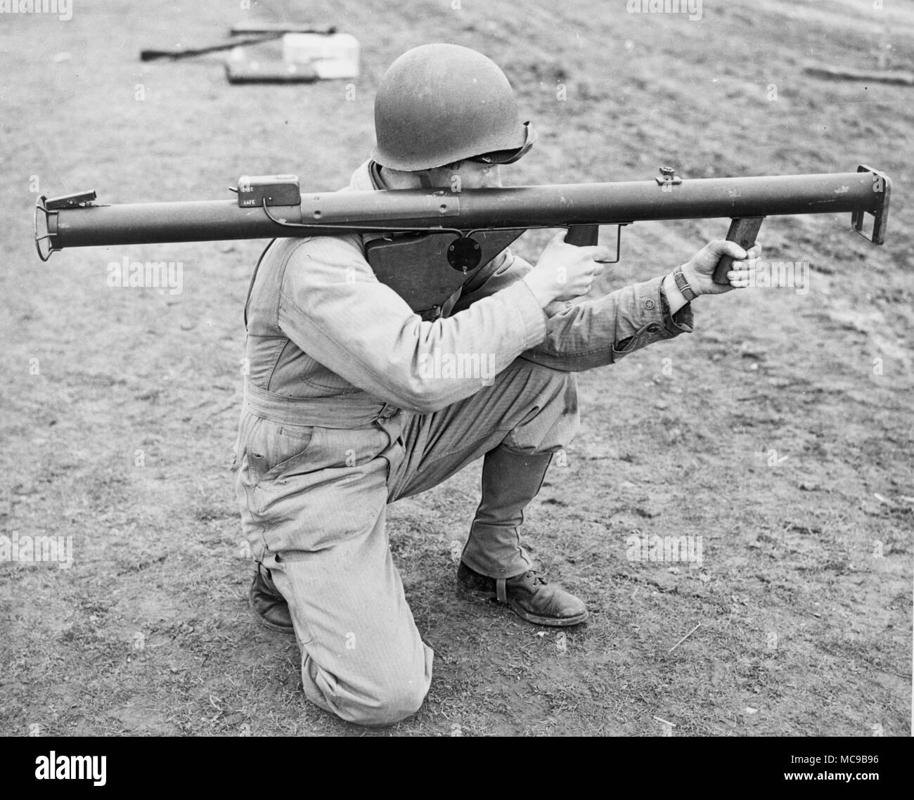 Bazooka, Soldier holding an M1 'Bazooka'. Portable recoilless anti-tank rocket launcher weapon, widely fielded by the United States Army. - Stock Image