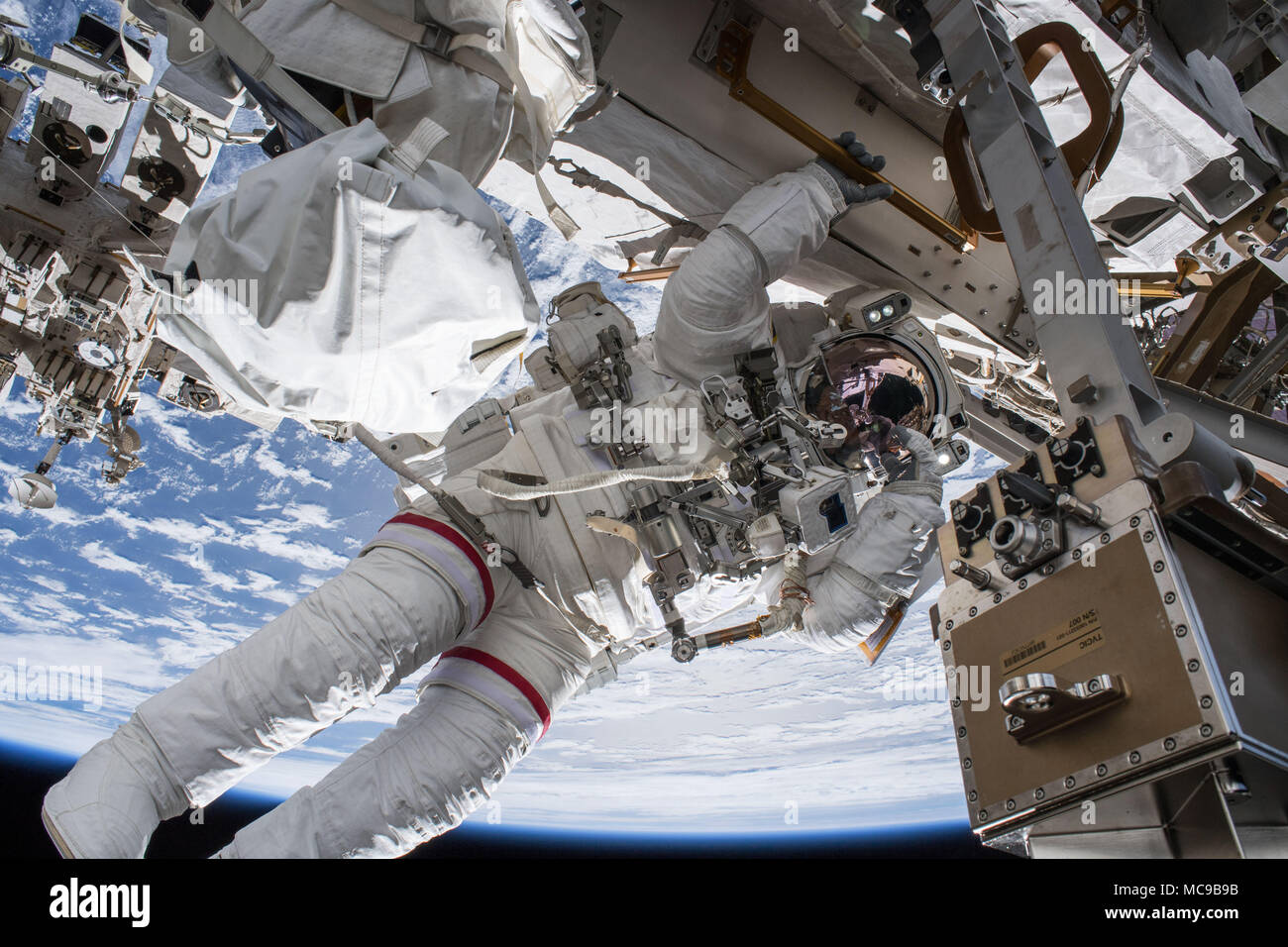 NASA astronaut Drew Feustel outside the International Space Station while conducting a spacewalk, March 29, 2018. - Stock Image