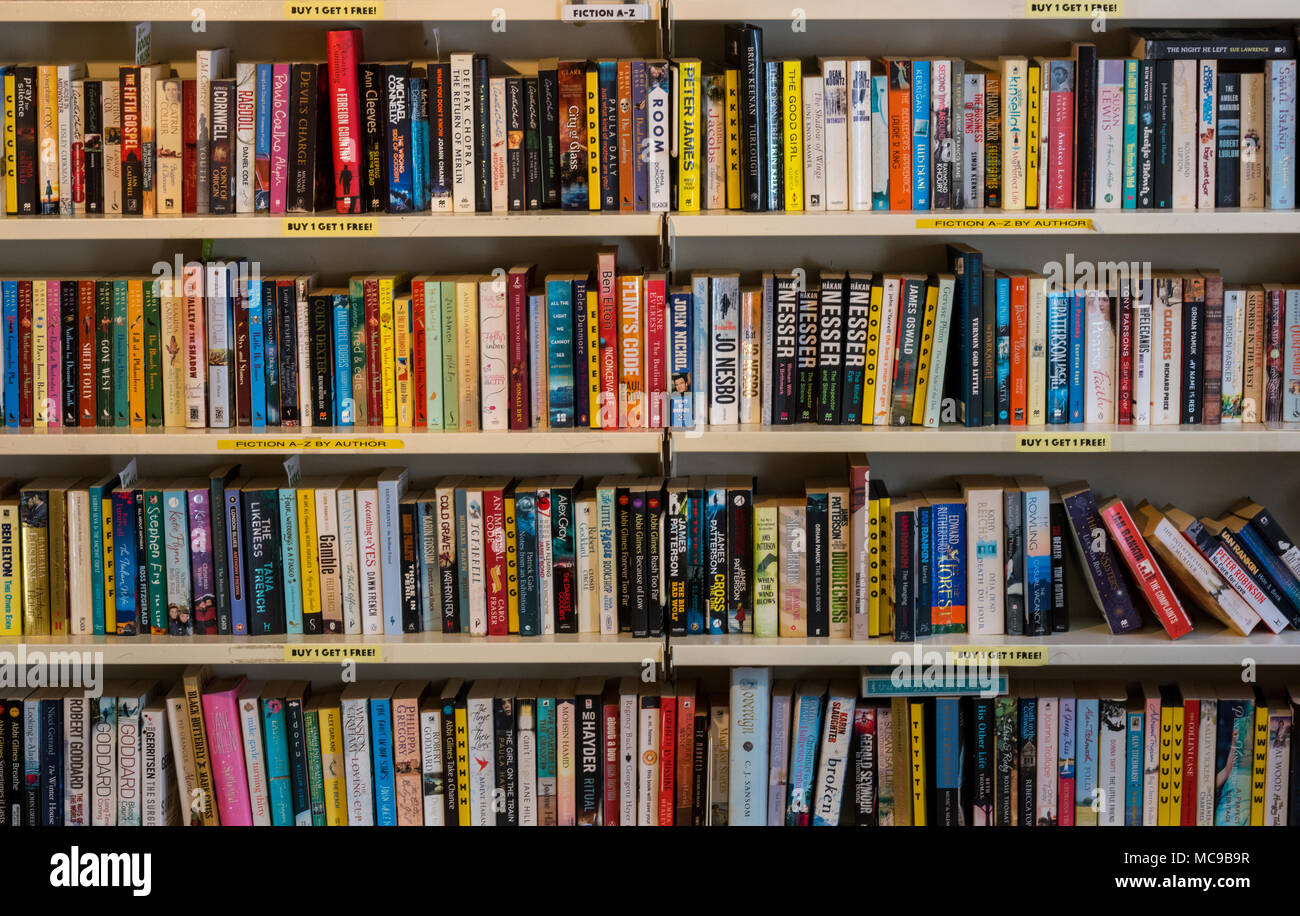 Shelves and rows for second hand used books in a shop selling volumes and publications that have seen previous use. Second hand used book stores. - Stock Image