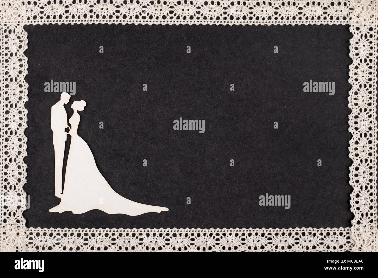 Bride And Groom Silhouette On Retro Album Page Framed With Lace