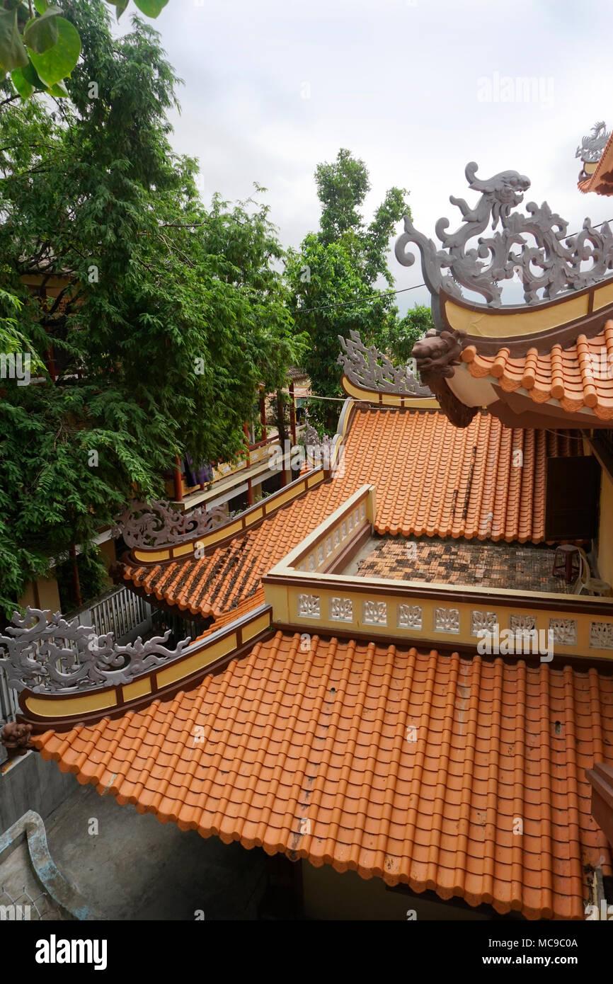 Clay tile roofs of Chua Long Son Pagoda, Nha Trang, Vietnam Stock Photo