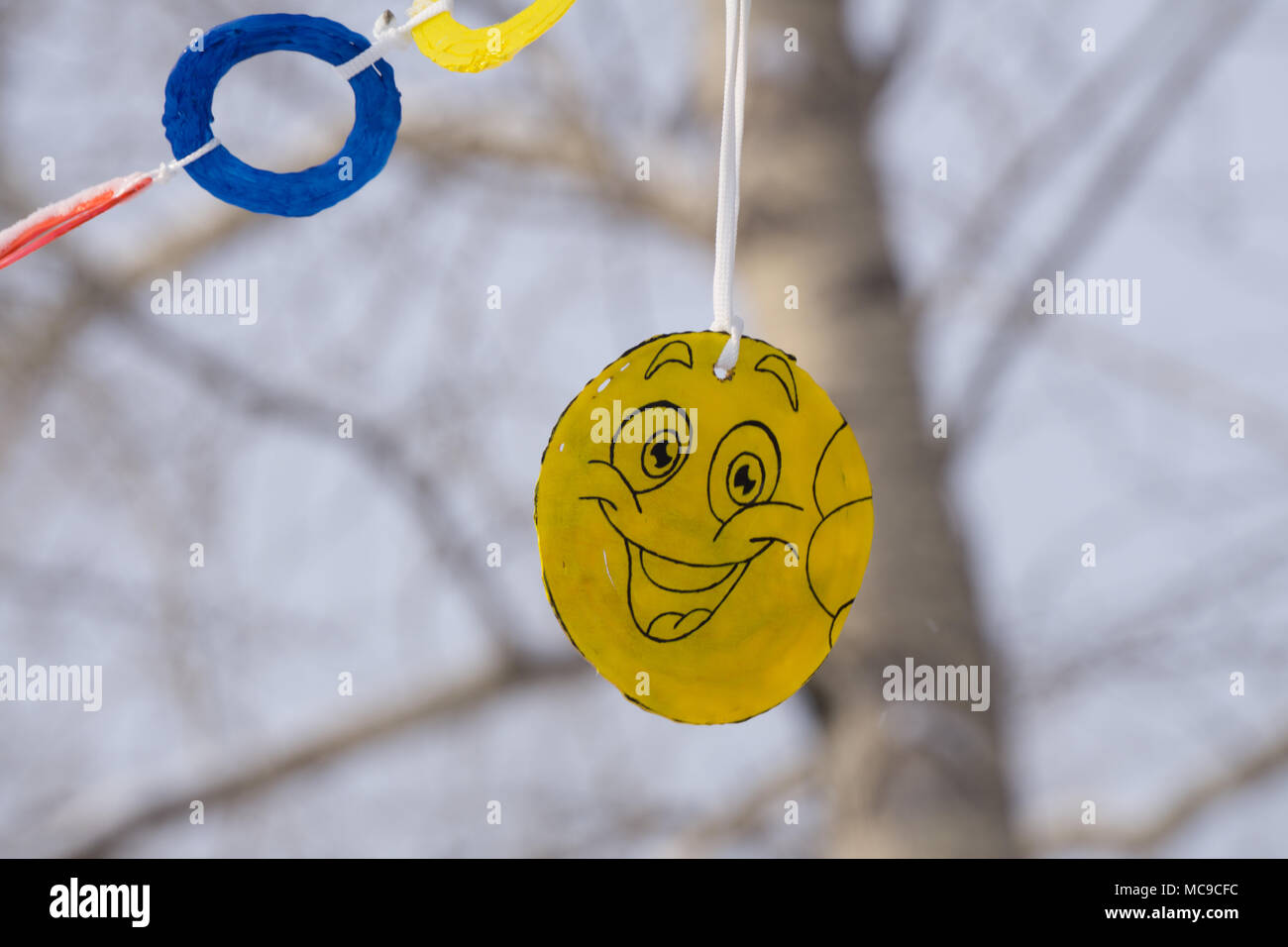 The Image Is A Yellow Ball With A Smiley Face Emoticon On A Street