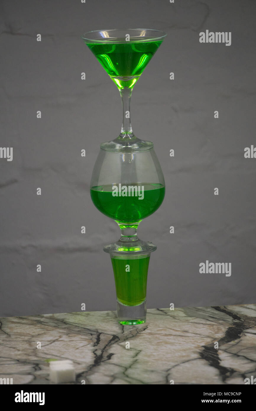 Absinthe shots near sugar cubes on white background top view copy space Stock Photo