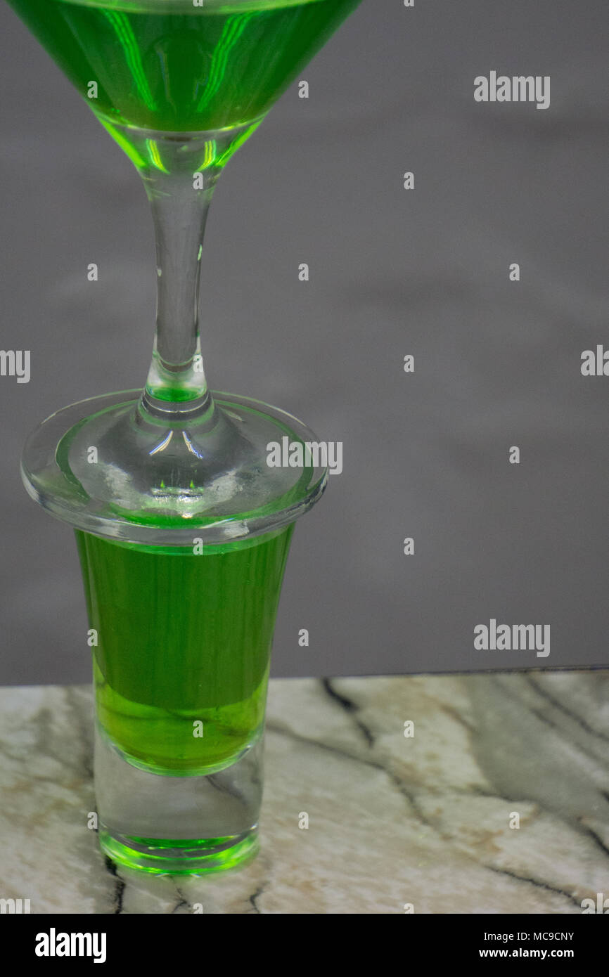 Cocktail absinthe with vodka in martini glass print print for skinned kitchen background interior bar products home furnishings trendy design black gr - Stock Image