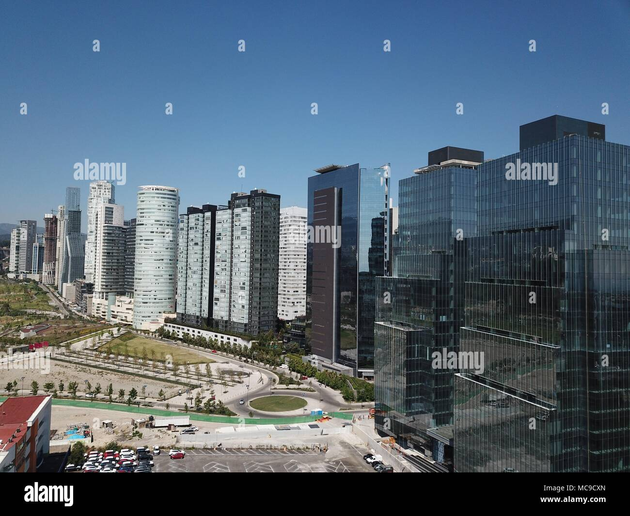 Skyscrapers at Mexico City around Reform Avenue with blue sky - Stock Image