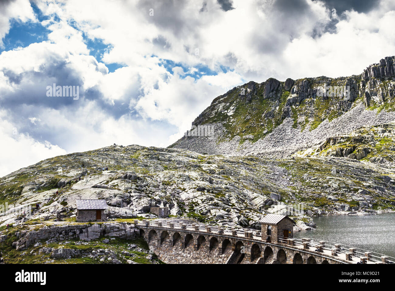 The dam of the lake of vaca. Pass of the cow from Tito Secchi refuge in Valsabbia, Brescia, Italy. - Stock Image