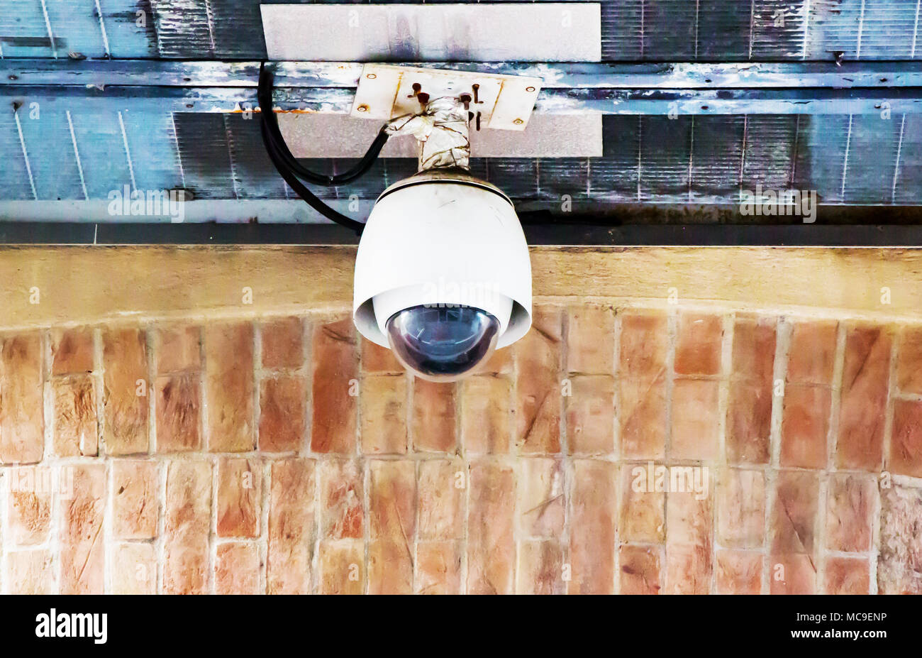 Security CCTV Camera on the old wall. Stock Photo