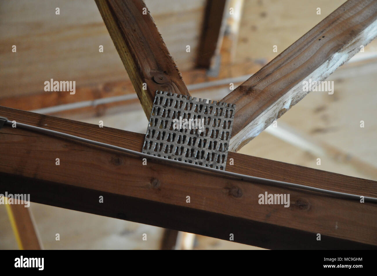 Metallic timber truss on a roof - Stock Image
