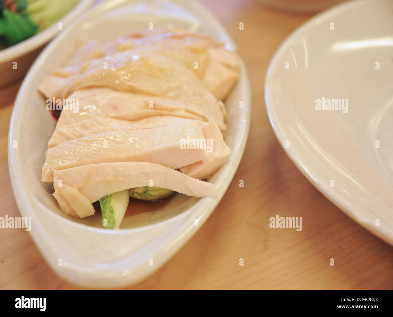Delicious legendary Singaporean Hainanese chicken rice with two tones dipping sauce - Stock Image