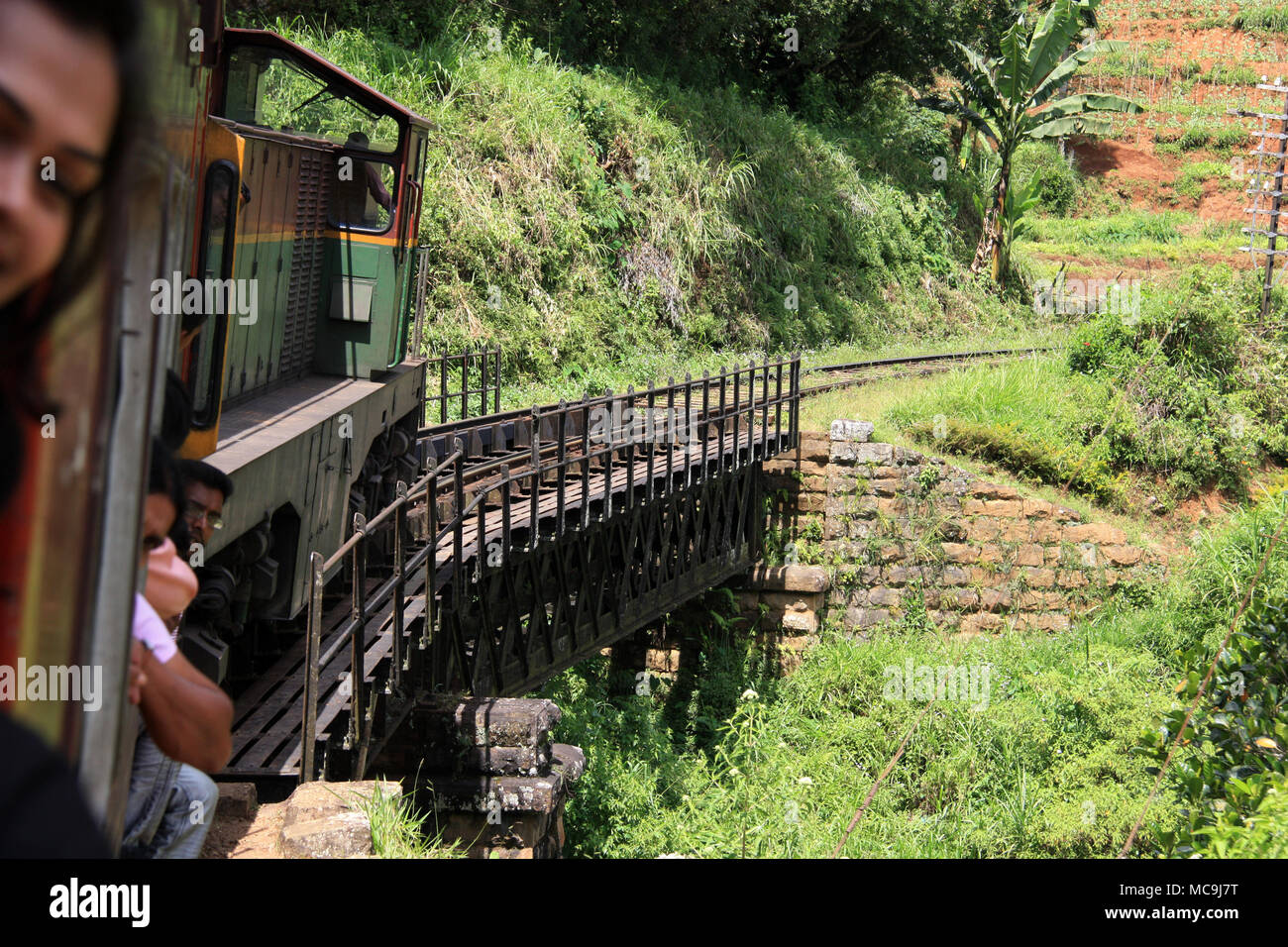 Taking a scenic train ride from Ella to Kandy, passing a thrilling truss bridge - Stock Image