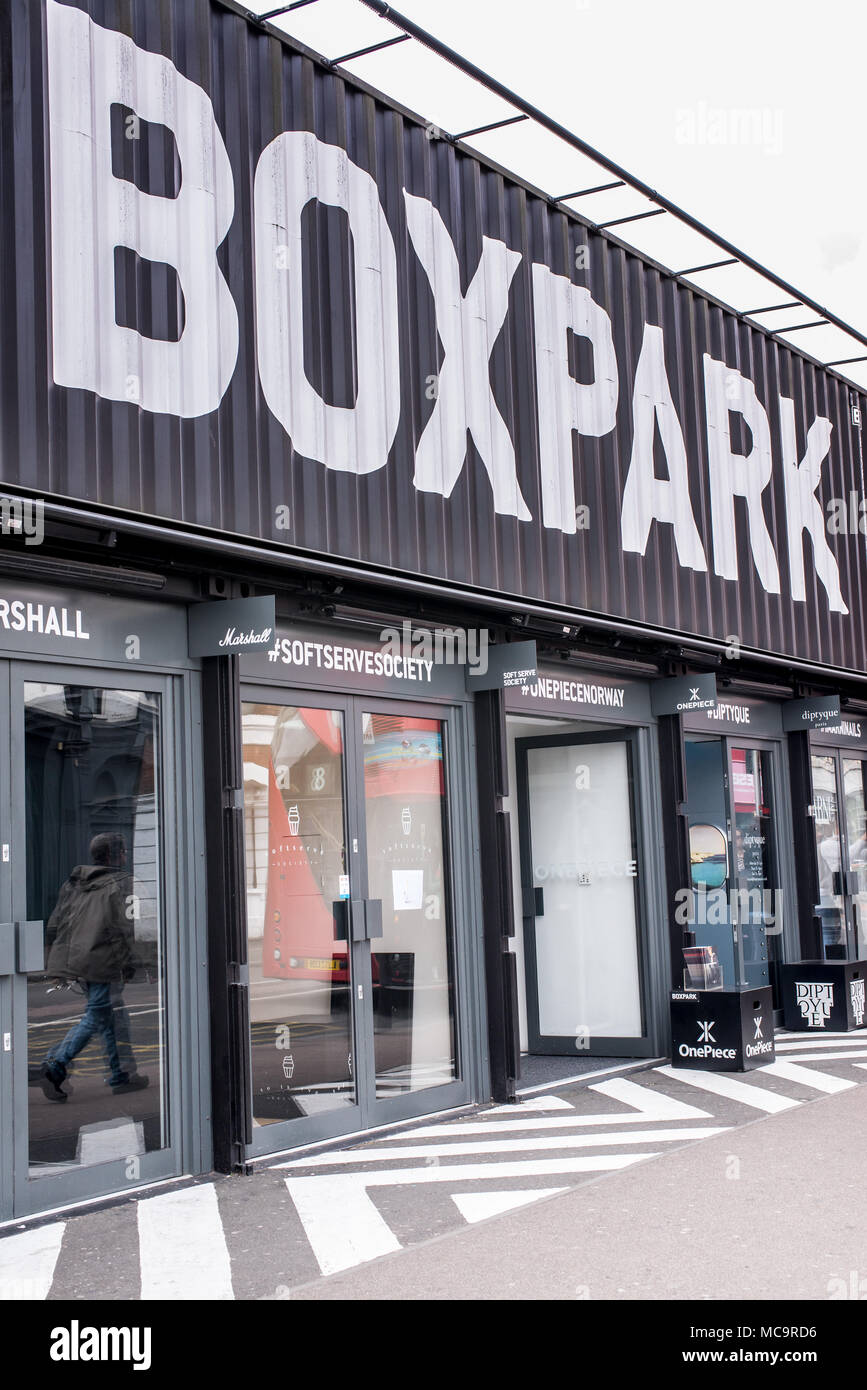 London, England - September 2016: BOXPARK, a cool pop up shopping venue with several indie shops and bars in Shoreditch, London, UK. - Stock Image