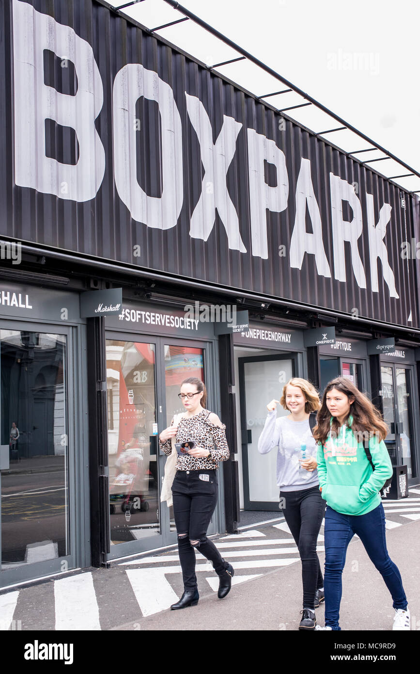 London, England - September 2016: People walking at the BOXPARK, a cool pop up shopping venue with several indie shops and bars in Shoreditch, London, - Stock Image