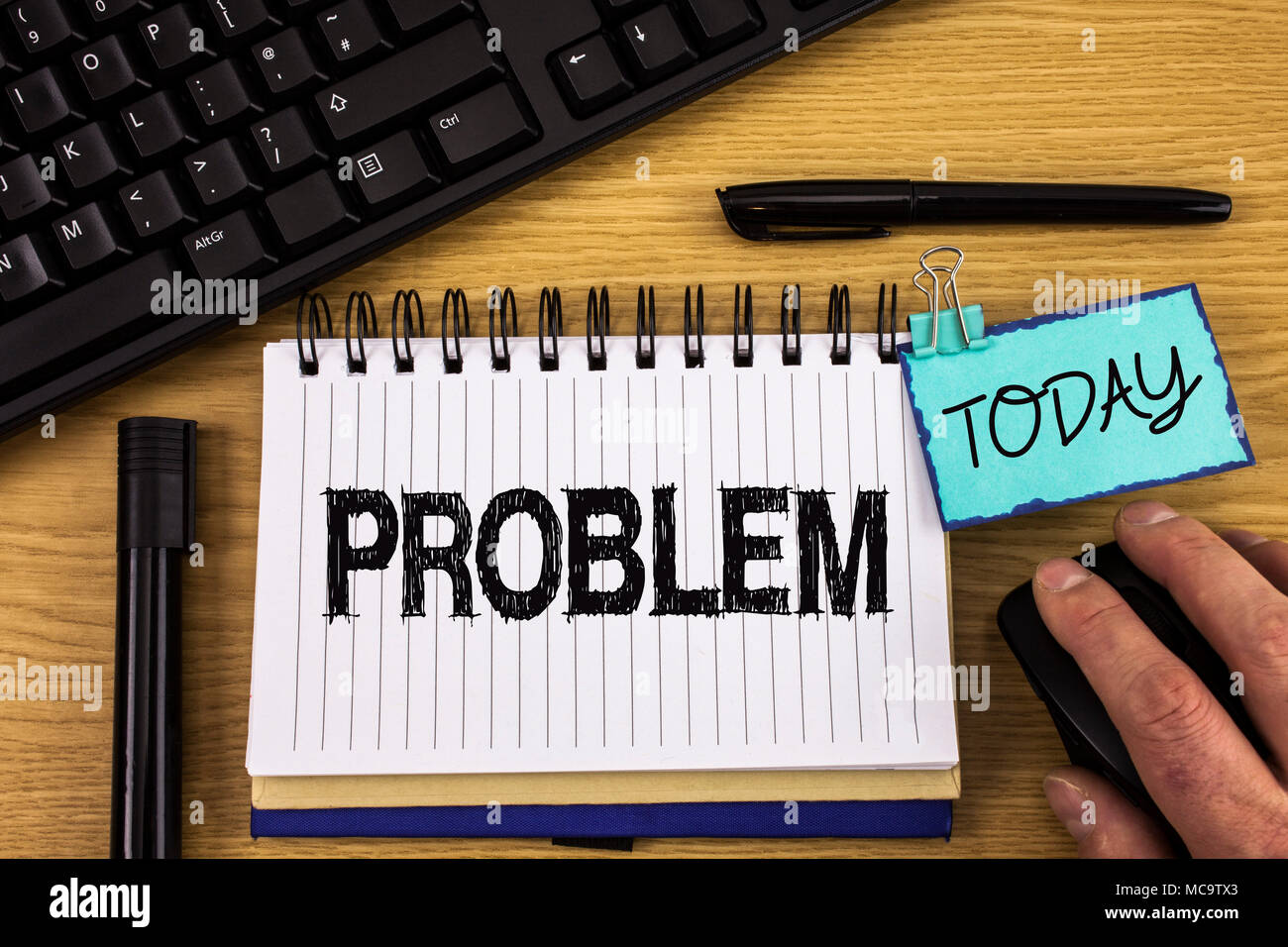 Text sign showing Problem. Conceptual photo Trouble that need to be solved Difficult Situation Complication written Noteoad wooden background Hand Mou - Stock Image