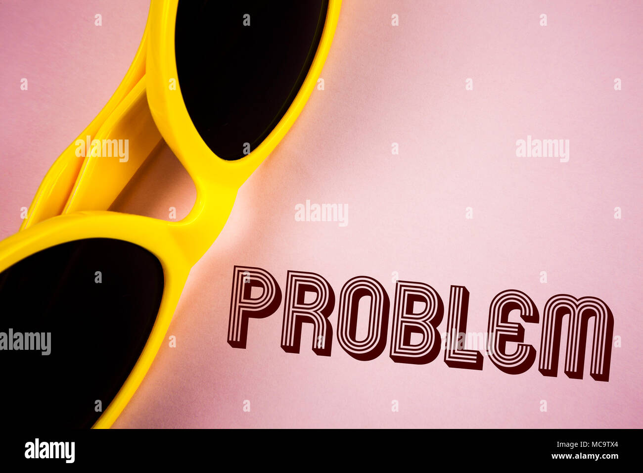Text sign showing Problem. Conceptual photo Trouble that need to be solved Difficult Situation Complication written Plain Pink background Sunglasses n - Stock Image