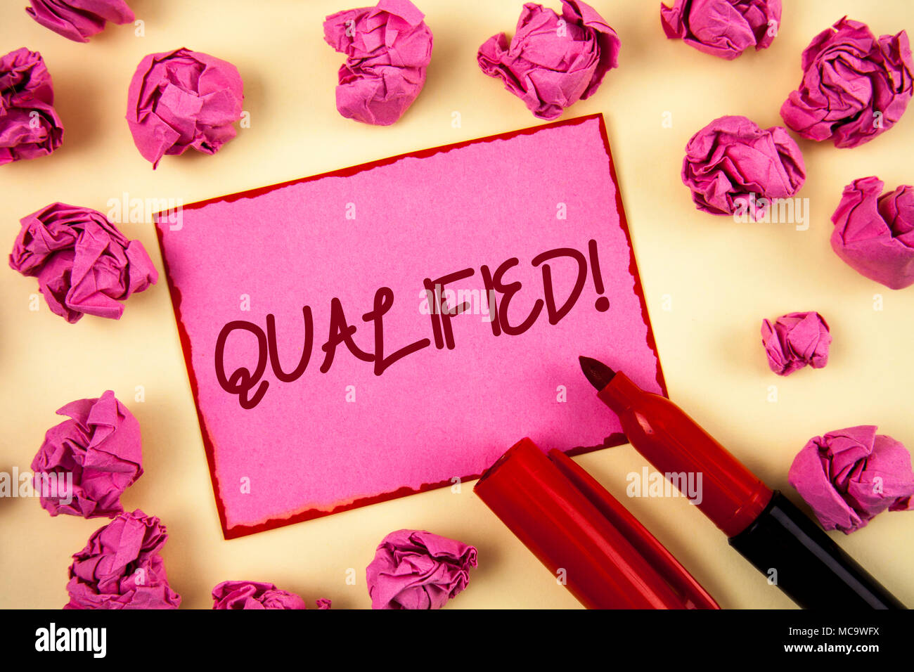 Word writing text Qualified Motivational Call. Business concept for Certified to perform a job Competent Experienced written Pink Sticky Note Paper pl - Stock Image