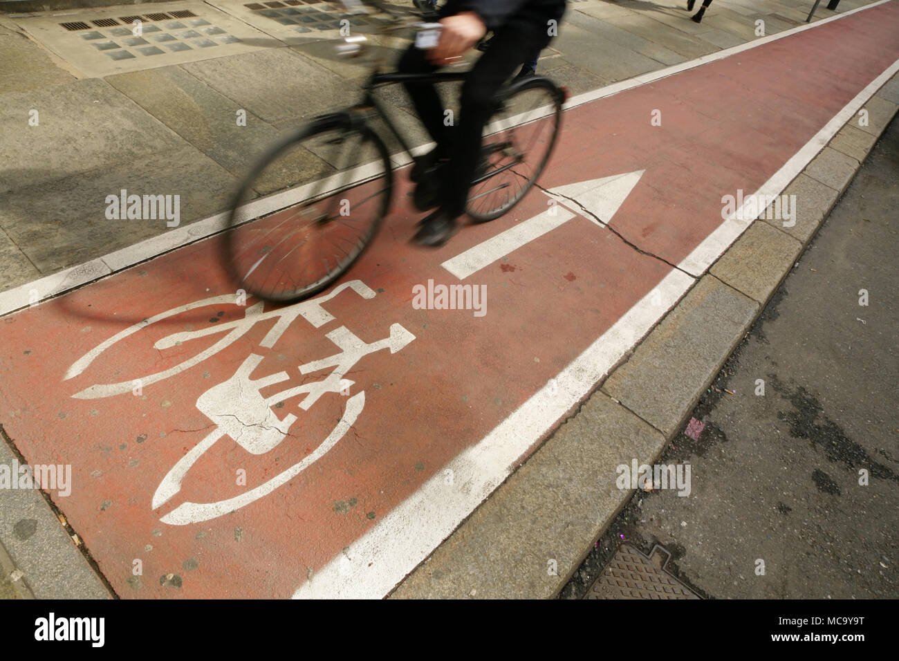 Cyclist going the wrong way on segregated cycle route. - Stock Image