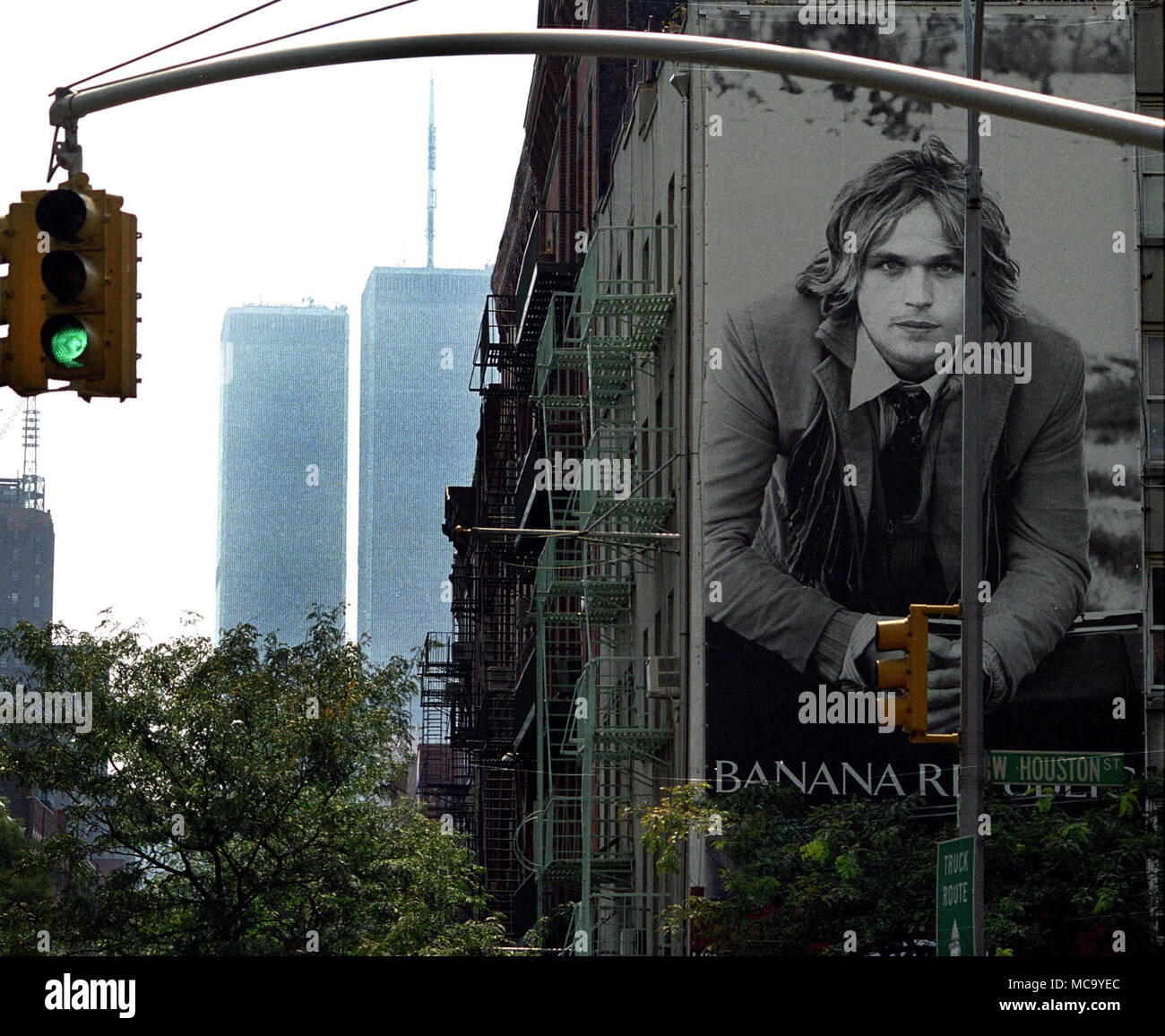 An apprehensive looking poster with the Twin Towers in the background the day before the 9/11 Terrorist attack on The World Trade Center, in New York City.  photo DON TONGE Photographer - Stock Image