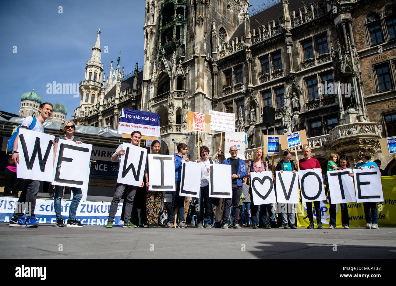 14 April 2018, Germany, Munich: Protestors carry signs reading 'We will Vote' during the 'March for Science'. Around the world there are rallies on Saturday, where people stand up for the liberty of research and teaching. Photo: Matthias Balk/dpa Stock Photo