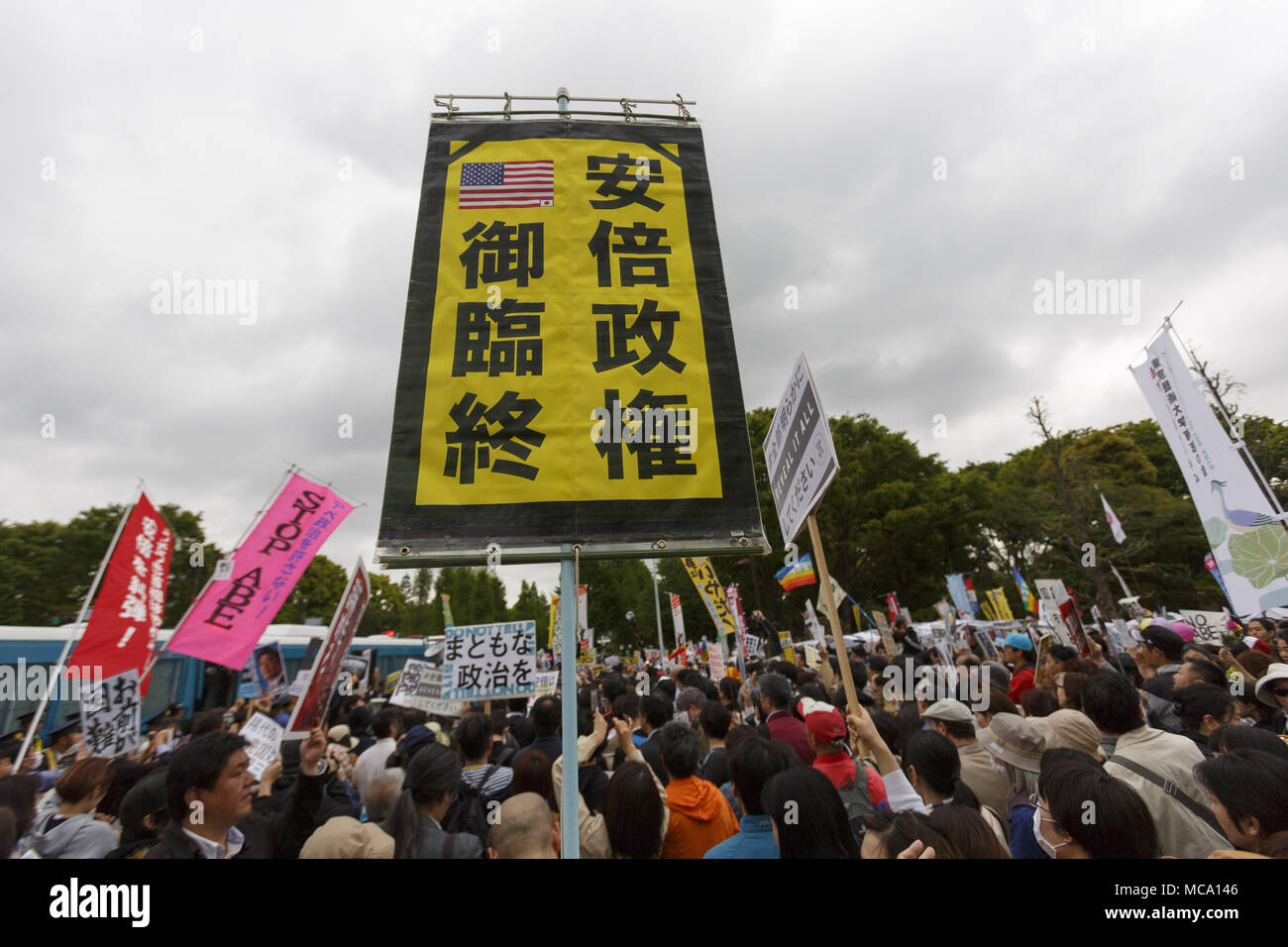 Tokyo, Japan. 14th Apr, 2018. Anti-Abe protesters gather in front the National Diet Building claiming PM Shinzo Abe's resignation in Tokyo, Japan. Organizers claim about 30,000 protesters joined the rally demanding Abe's resignation for the Moritomo Gakuen and Kake Gakuen scandals. Credit: Rodrigo Reyes Marin/via ZUMA Wire/ZUMA Wire/Alamy Live News - Stock Image