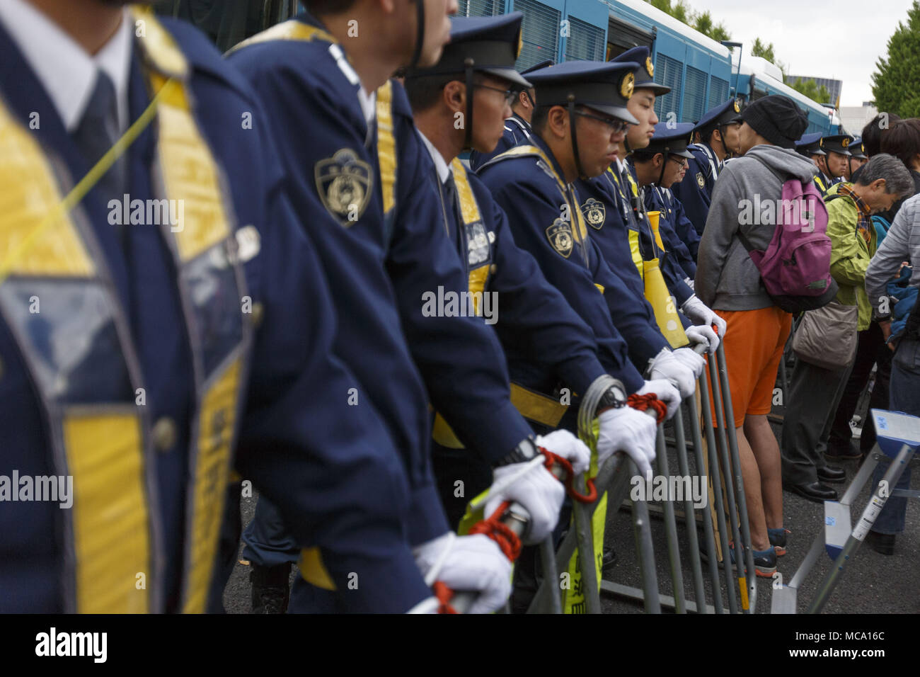 Tokyo, Japan. 14th Apr, 2018. Tokyo Metropolitan Police restraints the access to the National Diet Building during a protest in Tokyo, Japan. Organizers claim about 30,000 protesters joined the rally demanding Abe's resignation for the Moritomo Gakuen and Kake Gakuen scandals. Credit: Rodrigo Reyes Marin/via ZUMA Wire/ZUMA Wire/Alamy Live News - Stock Image